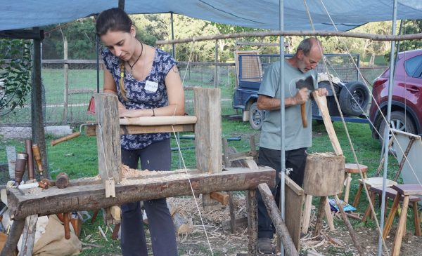 Marianne learning to turn wood and Roy making a tool handle